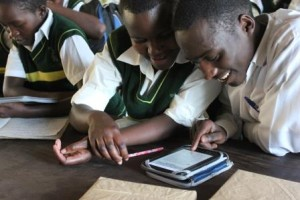 Students exploring their e-readers during the Bubaare Senior Secondary School launch