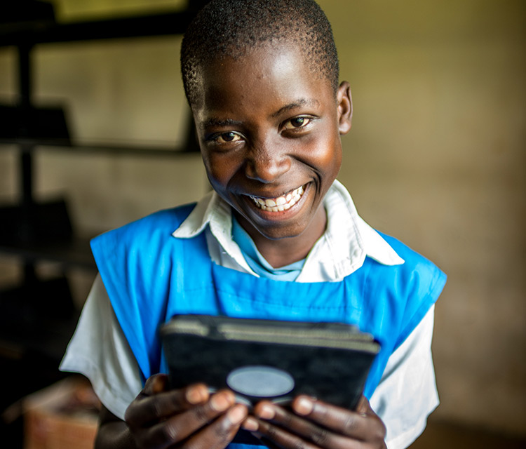Girl reading a book on her e-reader Africa