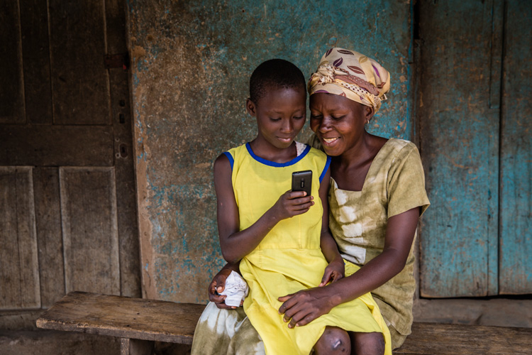 Mother reads books to her daughter on worldreader library