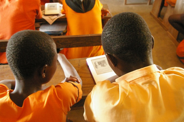Students at the first Worldreader project in Ghana read on Kindles