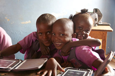 Happy kids in Africa with e-readers