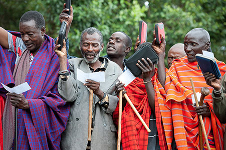 Masaai community with e-readers.