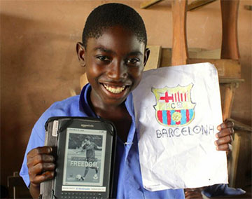 Worldreader student with Barca Worldreader banner on his Kindle and a drawing of the Barca crest