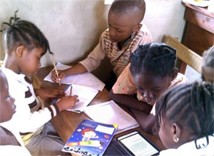 Students reading on Kindles at Agbado E-Learning Center in Ogun State, Nigeria