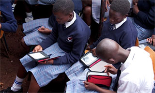 KGSA Students reading on Worldreader e-readers