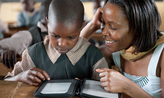 A Kilgoris student reading on a Worldreader e-reader