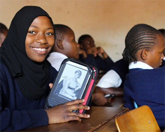 A student in Kibera, Kenya displays her Worldreader Kindle (Photo by CNN)