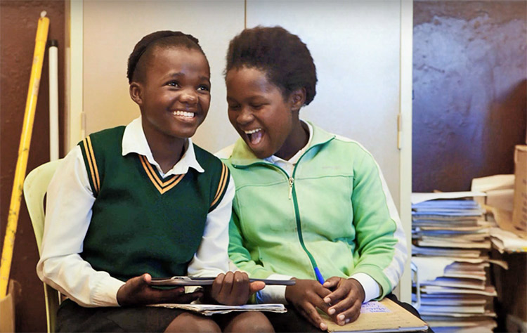 Girls using their new e-readers in class in South Africa