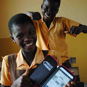 Pencils of Promise students show off their Worldreader e-readers