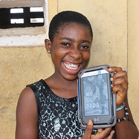 Photo of Worldreader student Setina with her BLUE Box e-reader