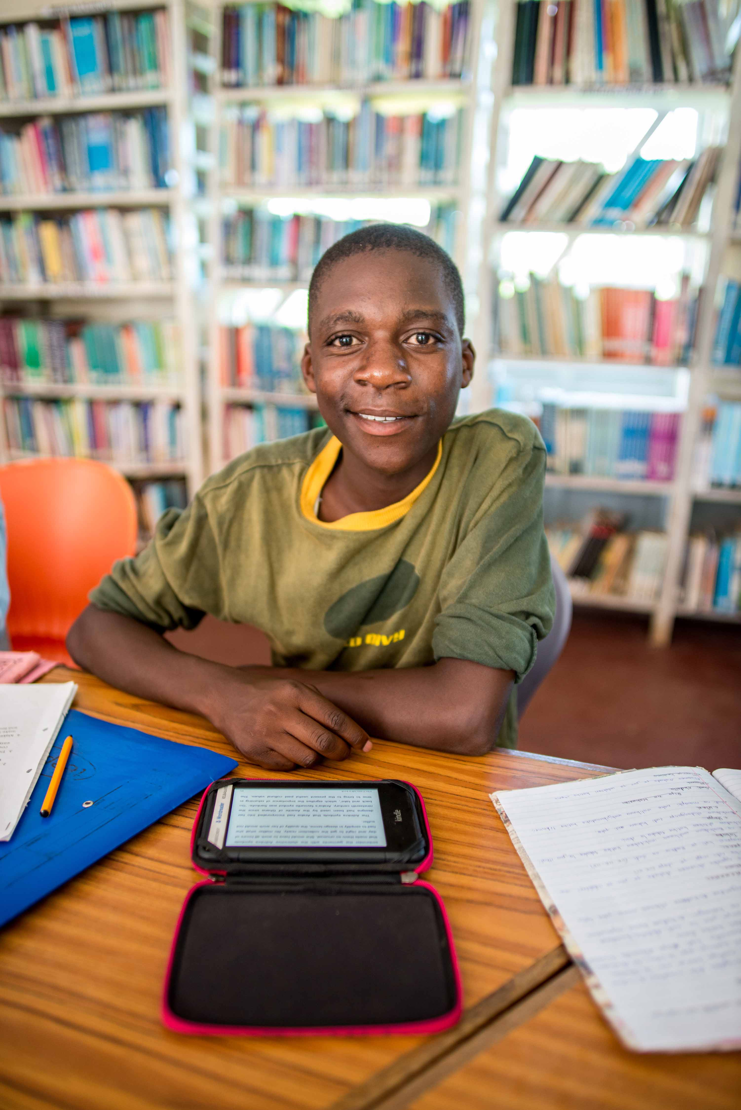 Boy reading at Nyilima Library