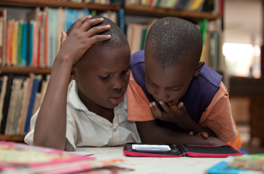 Children reading in Kenyan Libraries...now gone Digital!