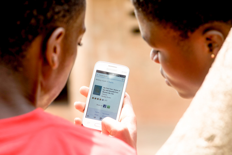 user reading from worldreader mobile in africa