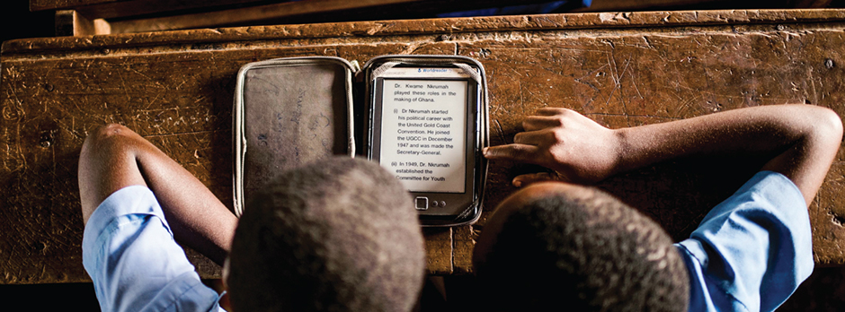 Students in a classroom reviewing e-reader