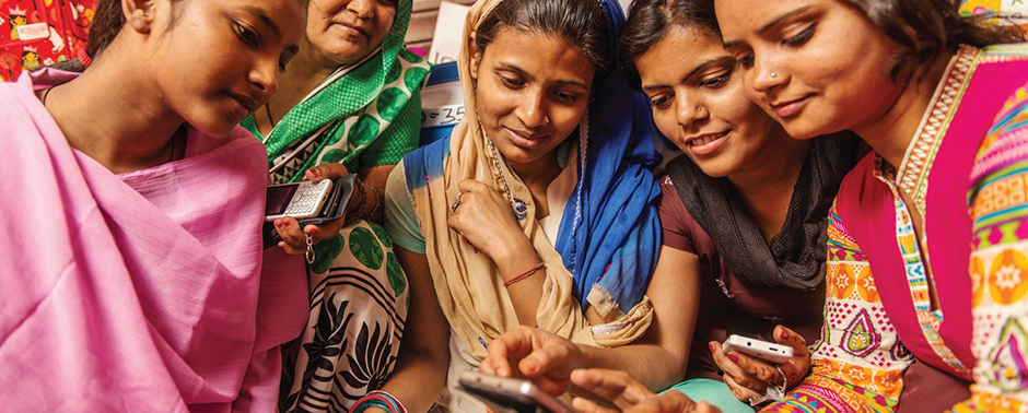 girls reading on their phone in India