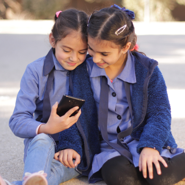 Girls reading on a mobile phone